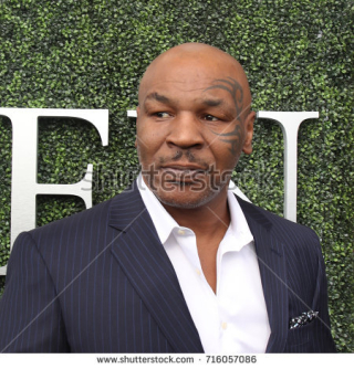 Stock-photo-new-york-august-former-boxing-champion-mike-tyson-attends-us-open-opening-ceremony-716057086